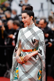 Fan Binging paired a gold Elie Saab tube clutch with a caped dress for the Cannes Film Festival screening of 'Amant Double.'