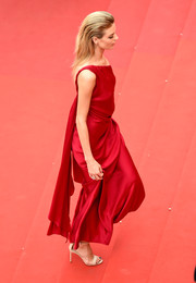 Martha Hunt donned a draped red one-shoulder gown for the Cannes Film Festival screening of 'Amant Double.'