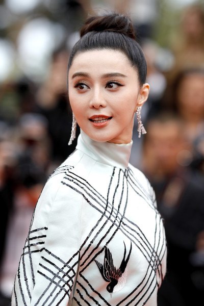 More Pics of Fan Bingbing Hair Knot (4 of 17) - Updos Lookbook - StyleBistro [hair,hairstyle,street fashion,lip,beauty,fashion,eyebrow,lady,chin,eye,red carpet arrivals,fan bingbing,amant double,cannes,france,cannes film festival,premiere,palais des festivals]