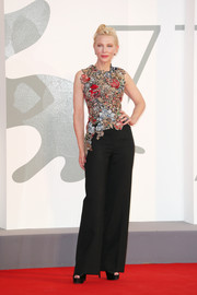 Cate Blanchett paired a fitted floral-embroidered top with black wide-leg trousers for the Venice Film Festival screening of 'Amants.'