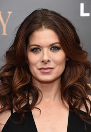 Debra Messing looked flirty-chic with her thick, bouncy curls at the New York premiere of 'Cafe Society.'