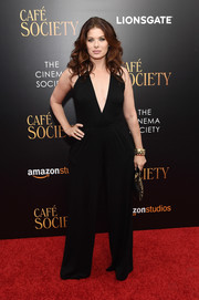 Debra Messing made a bold statement in a deep-V black jumpsuit at the New York premiere of 'Cafe Society.'