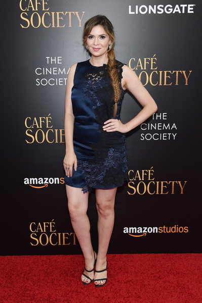 Carly Steel paired her dress with stylish black strappy sandals.