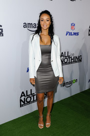 Draya Michele styled her outfit with silver ankle-strap heels.