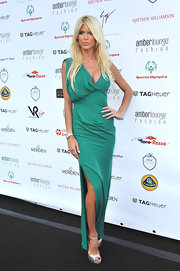 Victoria Silvstedt teamed her jade green gown with metallic champagne peep-toes.