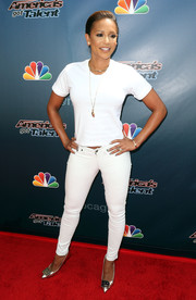 Melanie Brown flaunted her fit legs in white skinny jeans.