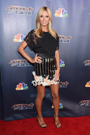 Heidi Klum matched her top with a floral-appliqued, striped mini skirt.