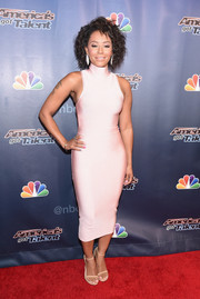 Melanie Brown poured her curves into a tight-fitting pale-pink tank dress by House of CB for the 'America's Got Talent' season 10 taping.