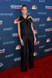 Heidi Klum was equal parts fun and sophisticated in this bow-adorned black jumpsuit by Wolk Morais at the 'America's Got Talent' season 11 live show.
