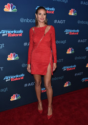 Heidi Klum cut a fierce figure in a zip-embellished red suede dress by Jitrois at the 'America's Got Talent' season 11 live show.