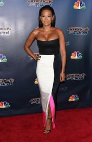 Melanie Brown flawlessly styled her top with a tricolor maxi skirt by Roksanda.