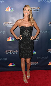 Heidi Klum chose silver ankle-strap sandals for added shine to her look.