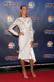 Heidi Klum completed her fierce look with a pair of gray snakeskin ankle-strap sandals.