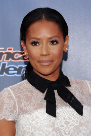 Melanie Brown went for no-frills styling with this center-parted ponytail at the 'America's Got Talent' season 9 event.