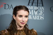 Emma Roberts channeled Scarlett O'Hara with this center-parted, half-up hairstyle at the American Image Awards.