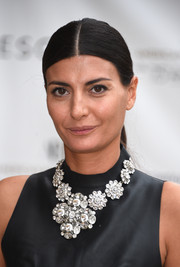Giovanna Battaglia topped off her look with a slicked-down, center-parted ponytail.