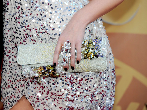 Meghan paired her sequin dress and perfectly polished nails with a geometric diamond ring that was sure to turn a few heads on the red carpet.