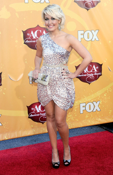 Meghan Linsey paired a sequined one shoulder frock with silver and black platform peep toes.