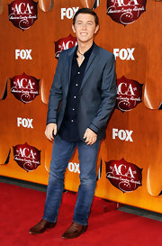 Scotty McCreery, the most recent winner of America Idol, looked classic country with a twist on the ACA red carpet. The young singer paired his western boots and blue jeans with a midnight blue blazer and untucked button-down.
