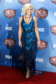 Kellie Pickler looked quite the glamour girl in a beaded, fringed blue gown at the American Country Awards press room.