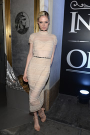 Coco Rocha kept it ladylike in a nude lace midi dress at the American Express Platinum Card celebration.
