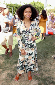 Yara Shahidi paired her sweet dress with ochre cross-strap mules.