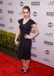 Vanessa Marano sported a simple navy sheath dress with burgundy piping at the AFI Life Achievement Award.