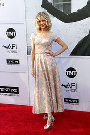 Meg Ryan contrasted her delicate dress with chunky silver platform sandals.