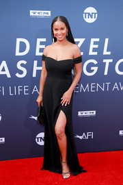 Joy Bryant was classic in a black off-the-shoulder gown by Reformation at the AFI Life Achievement Award Gala.
