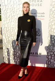 Vanessa Kirby paired her sweater with a black leather pencil skirt.