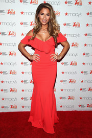Jessie James Decker went ultra feminine in a deep-coral cold-shoulder ruffle gown by Jay Godfrey at the Go Red for Women event.