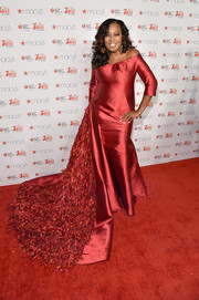 Star Jones made a grand entrance in a B Michael off-the-shoulder gown with a very long, fringed train during the American Heart Association Go Red for Women event.
