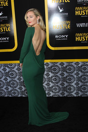 Elisabeth Rohm chose a simple yet dramatic emerald Randi Rahm evening dress, featuring an open back and draped detailing, for the 'American Hustle' premiere in NYC.