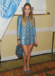 Taking the matchy-matchy look to a whole new level, Jennifer Lopez finished off her ensemble with a blue Dsquared2 snakeskin tote.
