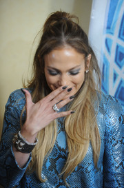 Jennifer Lopez amped up the fierceness with talon-like black nails at the 'American Idol XIV' photocall.