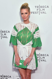 Nicky Hilton Rothschild sported a matchy-matchy studded clutch and lace dress combo by Valentino at the Tribeca Film Festival screening of 'The American Meme.'