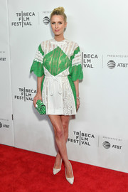 Nicky Hilton Rothschild coordinated her dress with a pair of white lace pumps.