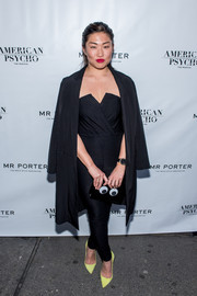 Jenna Ushkowitz finished off her jumpsuit with a black duster coat.