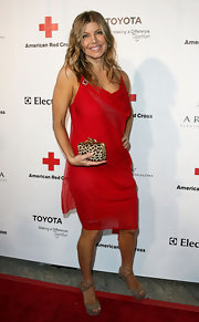 Fergie added a touch of the exotic to her look with a leopard print box clutch.