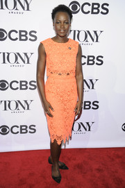 Lupita Nyong'o went matchy-matchy with this orange pencil skirt and crop-top combo.