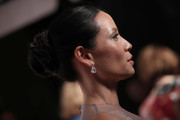 Lucy Liu styled her hair into a classic braided bun for the American Theatre Wing Centennial Gala.