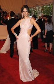 Alessandra posed dramatically at the Met Gala in this blush cutout gown.