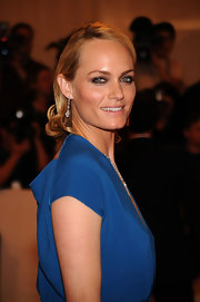 Actress Amber Valletta showed off her sleek waves while hitting the red carpet at the MET Gala. By keeping her hair off her face it allowed her dress to take center stage.