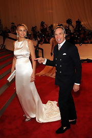 Tommy Hilfiger showed off his double breasted navy suit while walking the red carpet at the Met Gala.