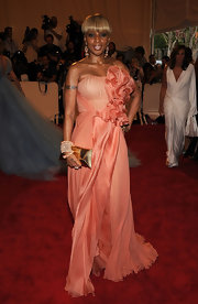 Mary J. Blige was radiant in a rose colored chiffon gown. The floaty dress featured a ruffled embellishment.