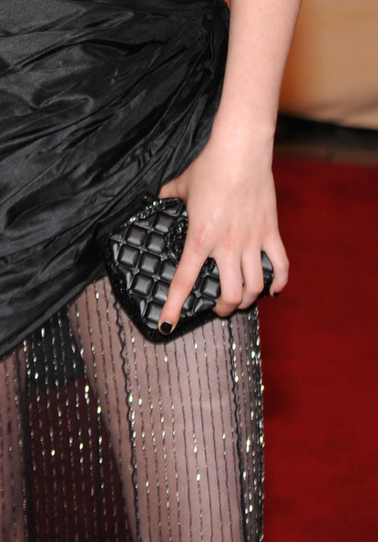 Kristen Stewart showed off her Chanel dress while walking the red carpet. She paired her Spring 2010 dress with a quilted Chanel clutch.