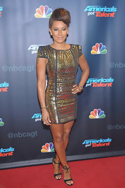 Mel B may have the nickname 'Scary Spice,' but her style is anything but! Just take a look at this structured studded mini dress.