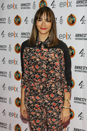 Rashida Jones went full on floral in a dizzying top, tucked into matching high-waist slacks.