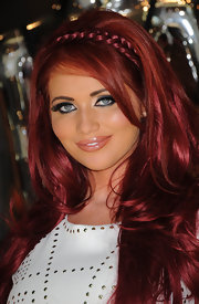 Amy Childs wore her ruby tresses with a shiny braided headband at the launch of her clothing line in London.
