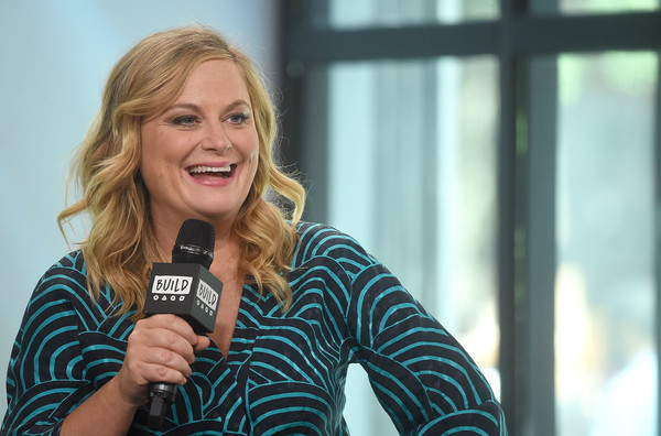 Amy Poehler Medium Wavy Cut [the house,movie,blond,smile,microphone,audio equipment,technology,photography,electronic device,long hair,brown hair,happy,amy poehler,build presents will ferrell,new york city,build studios,build studio]
